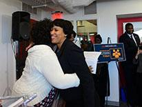 Mayor Bowser hugs woman